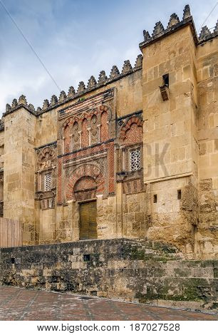 Wall of Mosque Cathedral of Cordoba also known as the Great Mosque of Cordoba with gate Spain