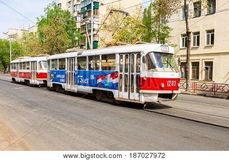 Samara Russia - May 09 2017: Samara public transport. Tram runs on the city street in summer sunny day