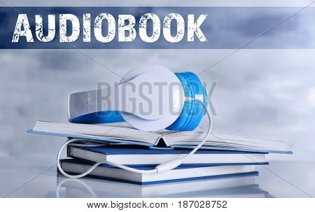 Audiobook concept. Books with headphones on color background