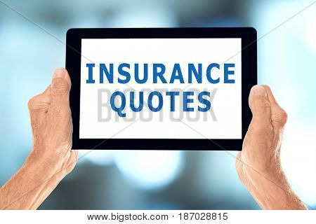 Insurance quotes concept. Elderly man holding tablet with text on screen against blurred background