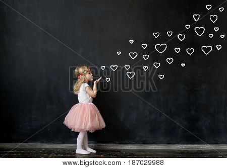Cute Girl Sends an air kiss.Drawing painted on a chalk board.