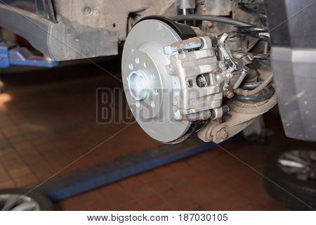 Car in the car repair for the braking repair with new parts