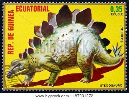EQUATORIAL GUINEA - CIRCA 1978: a stamp printed in Equatorial Guinea shows Stegosaurus Prehistoric Animal circa 1978