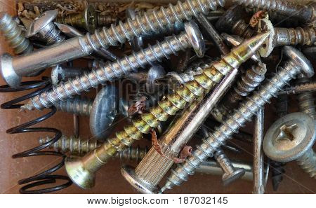 Mixed screws and nails. Industrial background. Home improvement. Lot of fasteners.
