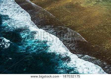 Highly detailed aerial image of ocean surf
