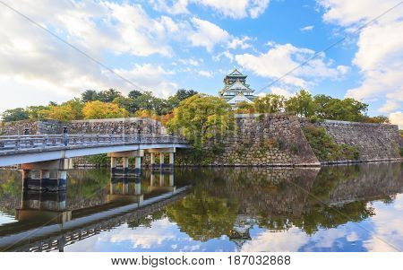 Beautiful of Osaka Castle in Osaka city with autumn leaves season in Japan
