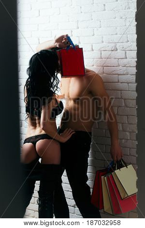 Sexy Couple With Shopping Bags
