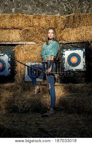 Woman Archer Holding Bow And Arrow At Archery Targets