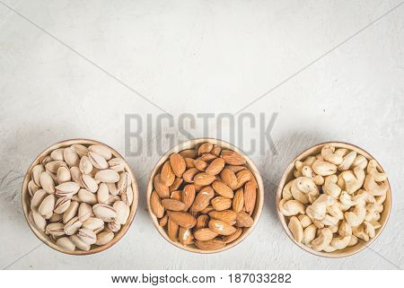 Selection Nuts On A White Stone Table