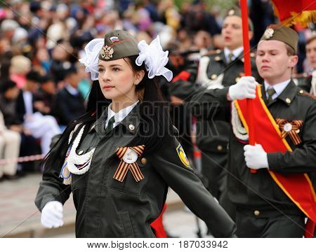 Orel Russia - May 9 2017: Victory Day selebration. Young people in cadet unform marching with banner closeup
