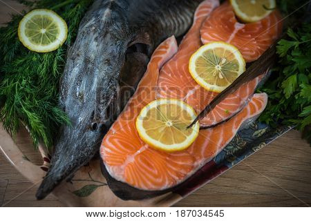 Sturgeon Decorated With Lemon And Dill And Parsley