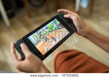 Hong Kong, 16 May 2017 -:Woman playing game on Nintendo Switch console at home