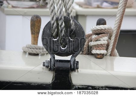 A sheave and belaying pin on a sailing ship on the Great Lakes