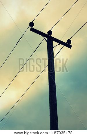 Wooden telegraph pole and the afternoon sky