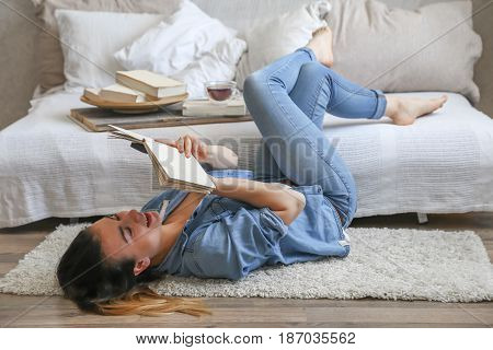 Girl Reading A Book In A Cozy Room