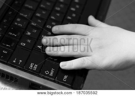 Baby Boy Hand On The Computer Keyboard