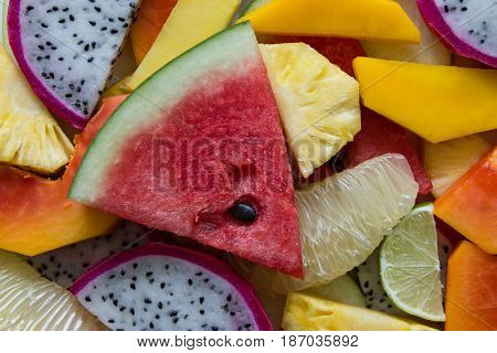 Mixed Ripe And Fresh Fruits Closeup For Colorful Background. Dragon Fruit, Pineapple, Papaya, Lime,