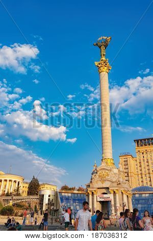 Kiev, Ukraine - September 11, 2016: People walk, take pictures and relax in front of Independence Monument with the Statue of Berehynia at the top Maidan Nezalezhnosti, Independence Square.