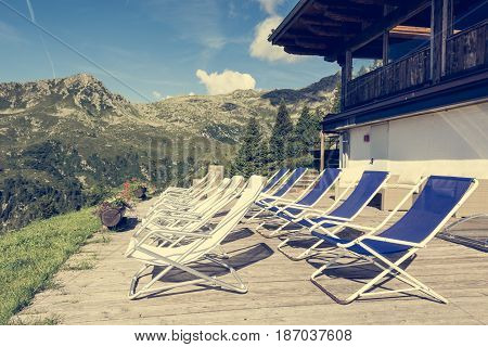 Terase with empty chairs. Mountain resort above Madonna di Campiglio.