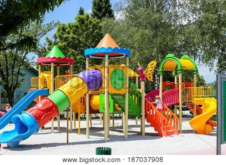 Park for children slides tunnels mazes in all colors happy children children's games
