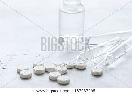 medicine set with pills and vials on doctor's office workplace background