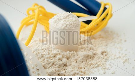 Protein And A Shaker Cup Close-up On White Background. Sports Supplements And Sports Nutrition For A