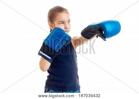 baby-girl standing in front of the camera and make gloves is isolated on a white background