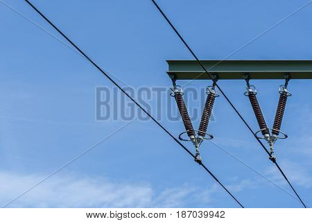 Close-up of Power Lines in front of a blue Sky. Energy Transmission. High Voltage
