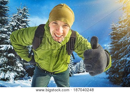 Smiling Active Hiker In A Snow Fall