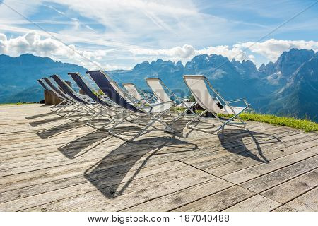 Mountain resort terase with empty chairs. Brenta ridge above Madonna di Campiglio.