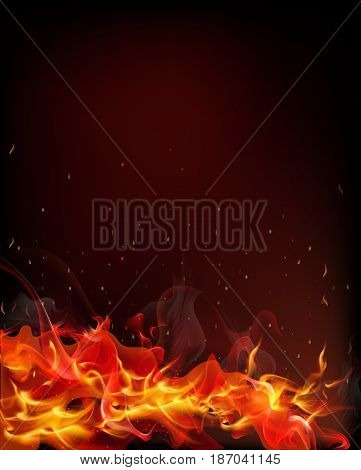 fire which spread from the tongues of flame from which soar into the air and heat scorched particles on a black background