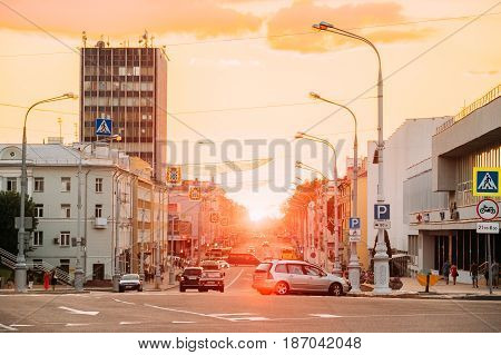 Gomel, Belarus  - July 30, 2016: View Of Lenin Avenue Going Straight To Lenin Square Under Yellow Sky Of Sunset. The Evening Traffic On Central City Street.