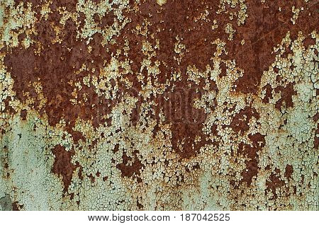 Rusty metal with the paint peeled, old metal corroded surface. Old texture for backgrounds.