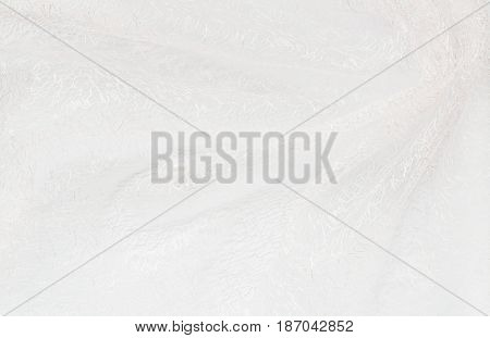Closeup of white folded fabric for background