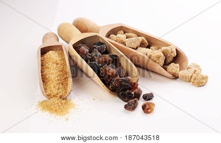 Composition With Brown Sugar On White Background