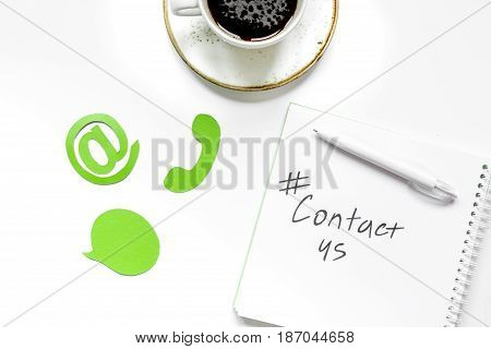 customer support company office with contact us text and signs on white desk background top view
