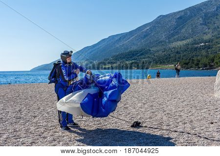 Brac Croatia - May 07 2016: parachutist landing on Zlatni Rat beach Croatia