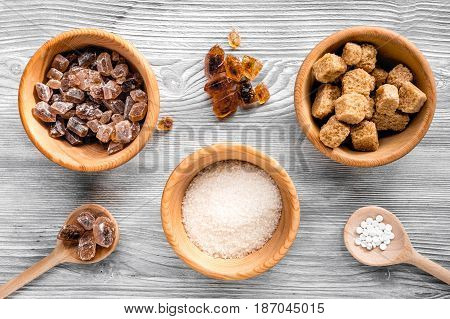 cooking sweets set with sugar in bowls on kitchen gray table background top view