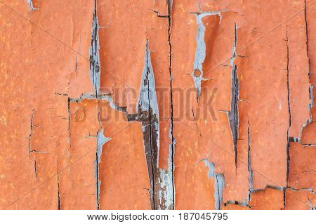 Aged weathered and peeling paint surface background.