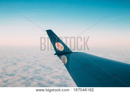 Minsk, Belarus - December 15, 2016: View from window on the wing of the aircraft with the Belavia logo. Belavia Belarusian Airlines is the national airline of Belarus.