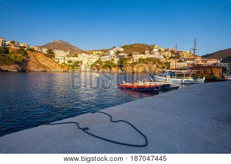 Bali Island Crete Greece - June 24 2016: Beautiful morning scenery with village Bali bay of Mediterranean sea and boats of local fishermen and and the big old wooden ship for walking tourists in the sea