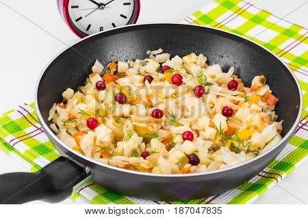 Stewed cabbage in frying pan with vegetables. Studio Photo
