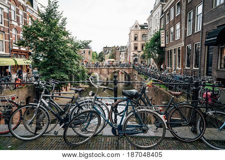 Utrecht Netherlands - August 4 2016: Canal area. Bicycles parked on a bridge over the canal