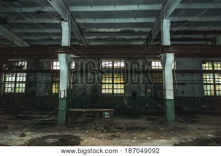 Inside abandoned building factory or warehouse, big empty abandoned room or hall