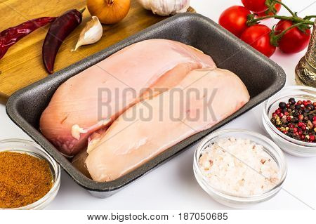 Chicken breast fillets raw in food packaging tray. Studio Photo