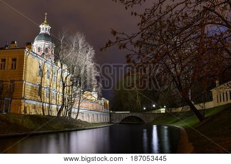 Svyato-Troitskaya Alexander Nevsky Lavra Church of the Annunciation on the Bank of the river Monastyrka Saint-Petersburg at night. The view from the other side of the river