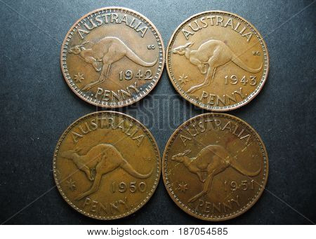 Predecimal vintage Australian One Penny copper coins. Reverse side with Kangaroo.