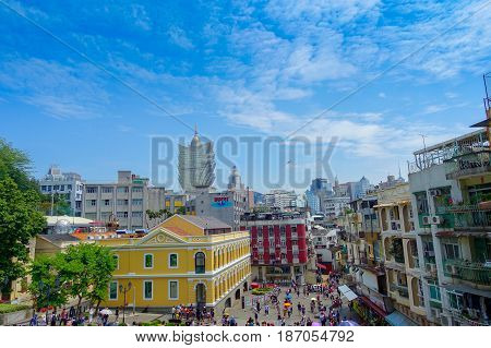 MACAU, CHINA- MAY 11, 2017: Macau city with buildings and behind the iconic hotel Grand Lisboa is a very big hotel and restaurant, also the oldest casino in Macau city.