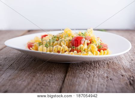 Fussili pasta with watercress and cherry tomatoes