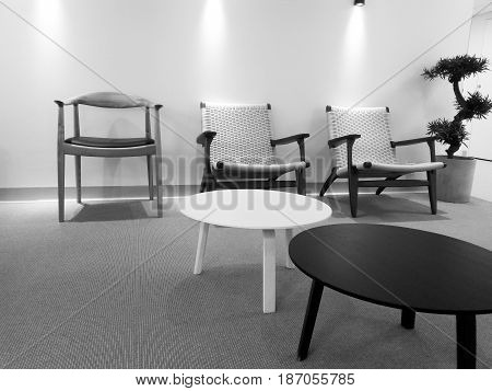 Black and white lobby interior with simple furniture.